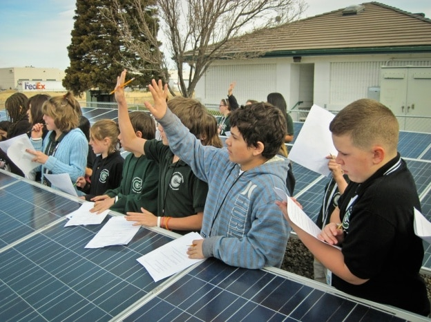 kids and solar panels