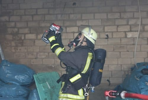 fire fighter using thermal camera